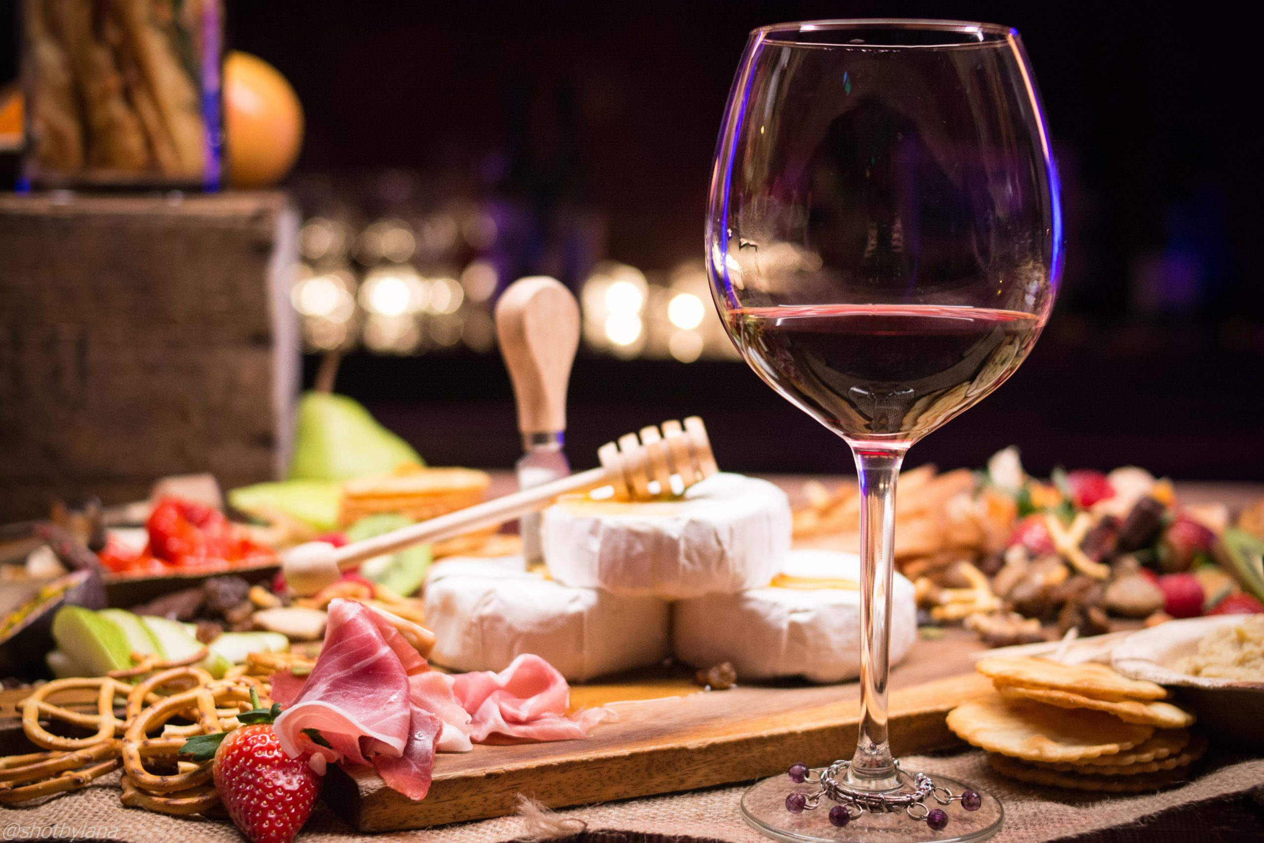 wine with cheese and meat board